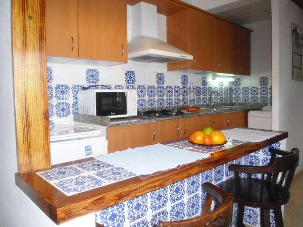 small and friendly complex of one bedroom apartments surrounded by a