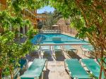 Sunbeds by the Pool at Flor Los Almendros Hotel