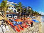 Loungers and Beach Front Dining at The Carmen Hotel